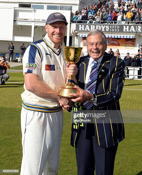 Andrew Gale captain of Yorkshire recieves the championship trophy from Club President Dickie Bird after their LV County Championship match between...