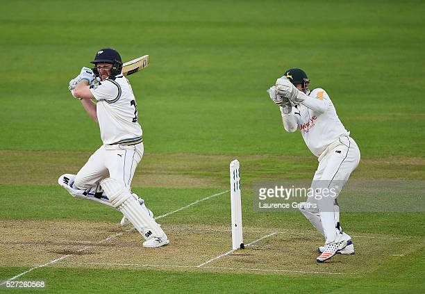 Andrew Gale of Yorkshire hits out in front of Chris Read of Nottinghamshire during the Specsavers County Championship Division One match between...