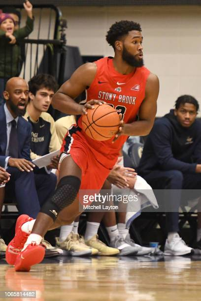 Andrew Garcia of the Stony Brook Seawolves dribbles the ball during a college basketball game against the George Washington Colonials at the Smith...