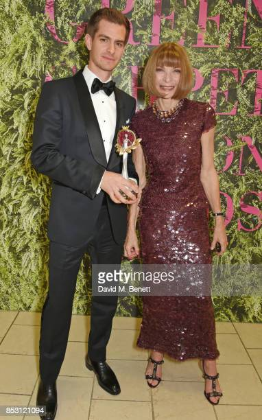 Andrew Garfield accepting the Best International Designer award on behalf of Green Carpet Fashion Award winner Tom Ford and presenter Anna Wintour...