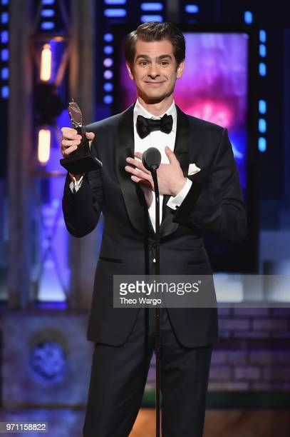 Andrew Garfield accepts the Best Performance by an Actor in a Leading Role in a Play award for Angels in America onstage during the 72nd Annual Tony...