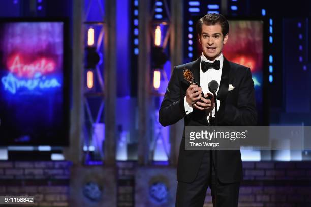 Andrew Garfield accepts the Best Performance by an Actor in a Leading Role in a Play for Angels in America onstage during the 72nd Annual Tony Awards...