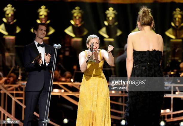 Andrew Garfield and Denise Gough present Billie Piper with the Best Actress award on stage during The Olivier Awards 2017 at Royal Albert Hall on...