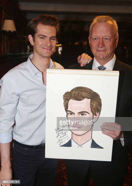 Andrew Garfield and Max Klimavicius pose at the unveiling of Andrew Garfield's caricature honoring his performance in the play 'Angels in America' on...