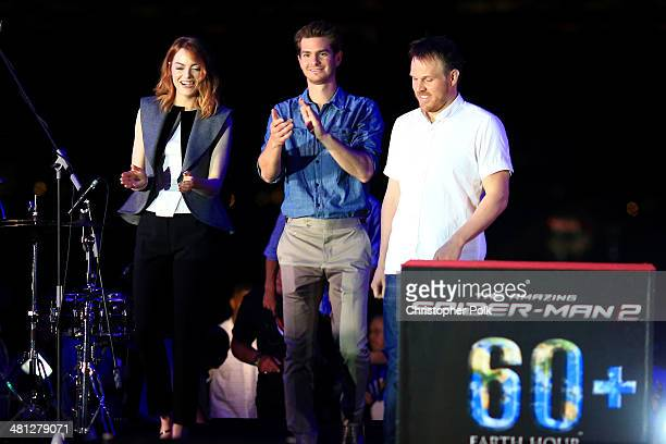 Andrew Garfield Emma Stone and Director Marc Webb of The Amazing SpiderMan 2 attend the Earth Hour KickOff with SpiderMan The First Super Hero...