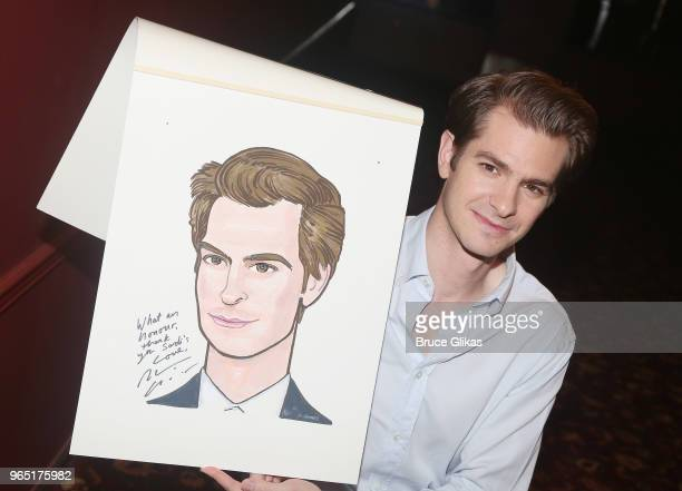 Andrew Garfield poses at the unveiling of Andrew Garfield's caricature honoring his performance in the play 'Angels in America' on Broadway at Sardis...