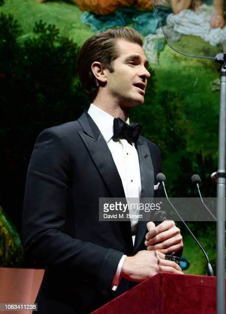 Andrew Garfield presents an award at The 64th Evening Standard Theatre Awards at the Theatre Royal Drury Lane on November 18 2018 in London England