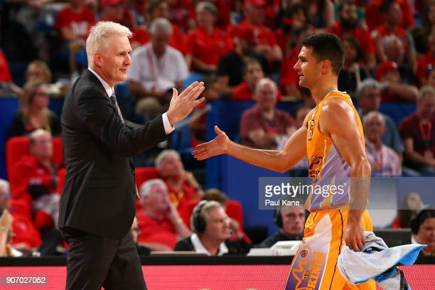 Andrew Gaze coach of the Kings acknowledges Kevin Lisch after checking out of thew game during the round 15 NBL match between the Perth Wildcats and...