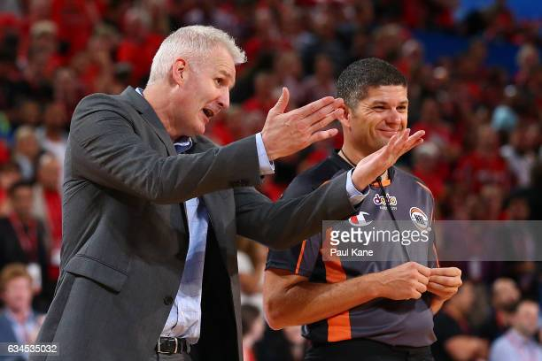 Andrew Gaze coach of the Kings talks with a referee during the round 19 NBL match between the Perth Wildcats and the Sydney Kings at Perth Arena on...