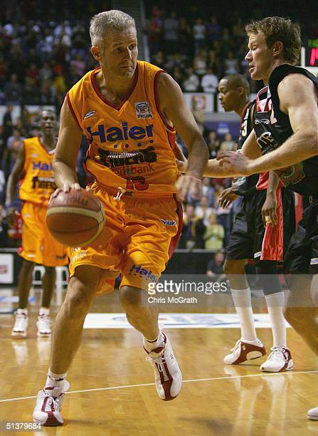 Andrew Gaze of the Tigers drives to the basket during the NBL round one match between the Wollongong Hawks and the Melbourne Tigers played at...