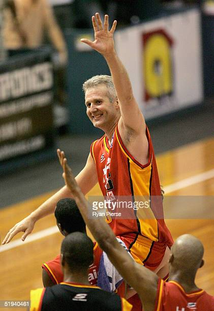 Andrew Gaze of the Tigers iis chaired off by teammates after his 600th NBL match the round 16 NBL match between the Melbourne Tigers and the Adelaide...