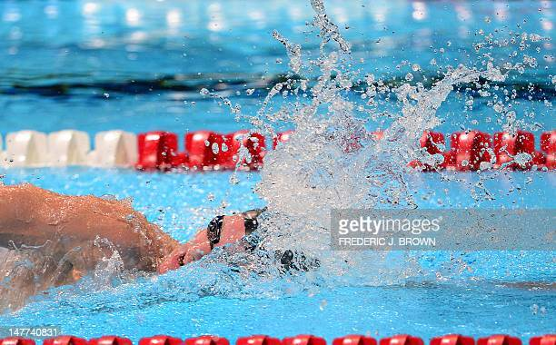 Andrew Gemmell swims to a first place finish on the last lap of the men's 1500M Freestyle final on the last day of the 2012 US Olympic Team Trials on...
