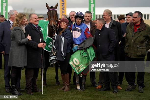 Andrew Gemmell the owner of Paisley Park with trainer Emma Lavelle as his horse wins the Sun Racing Stayers Hurdle on St Patrick's Thursday at...
