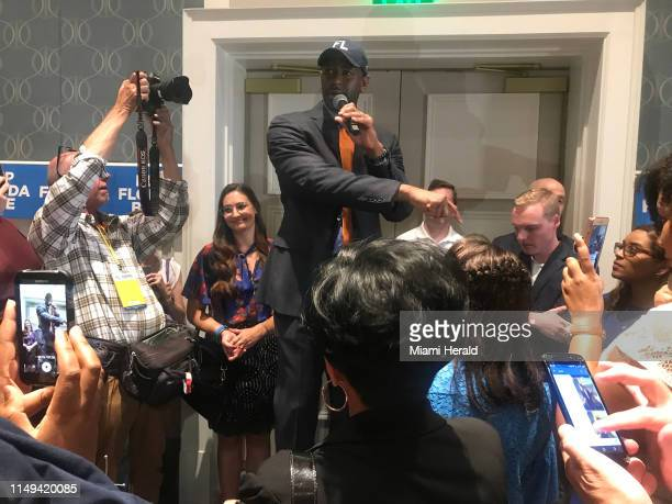 Andrew Gillum talks to a crowded room at Disney's Yacht Club Convention Center in Orlando Fla on June 7 about registering voters and beating Donald...