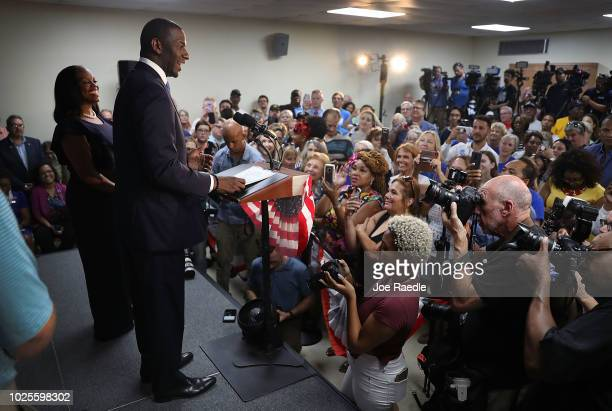 Andrew Gillum the Democratic candidate for Florida Governor stands next to his wife R Jai Gillum as he speaks during a campaign rally at the...