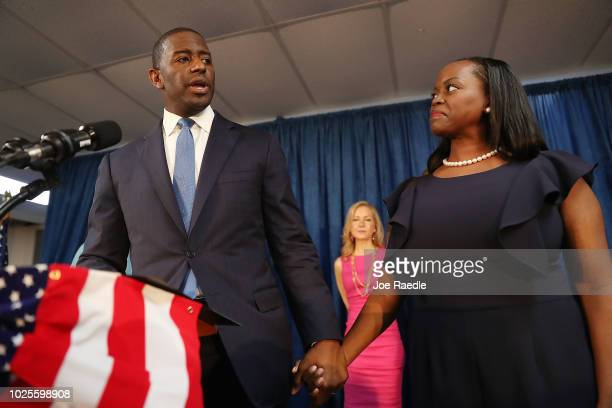 Andrew Gillum the Democratic candidate for Florida Governor stands with his wife R Jai Gillum as he speaks during a campaign rally at the...