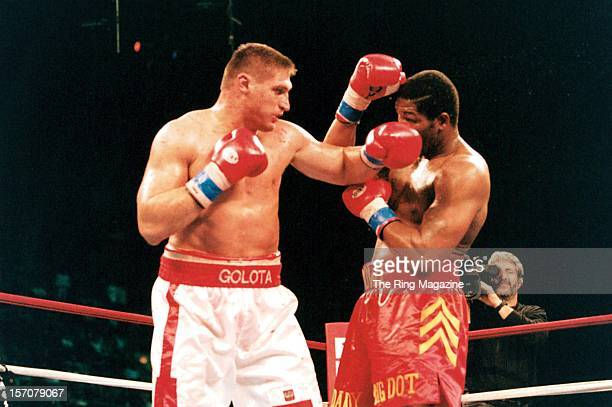 Andrew Golota connects with a left hook to Riddick Bowe during a fight at the Convention Center on December 14 1996 in Atlantic City New Jersey...