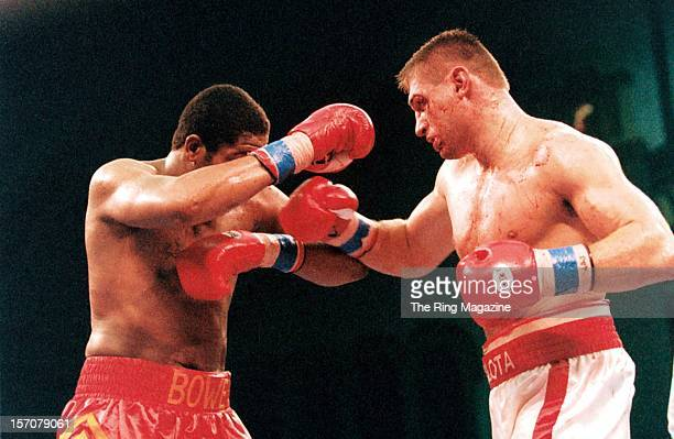 Andrew Golota connects with a right hook to Riddick Bowe during a fight at the Convention Center on December 14 1996 in Atlantic City New Jersey...
