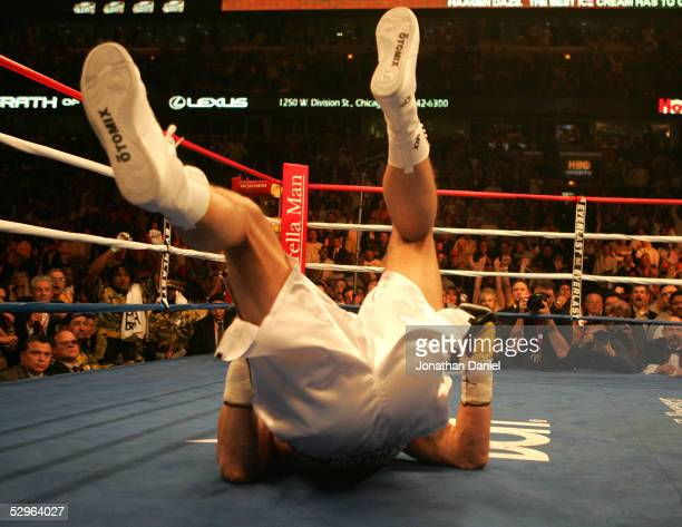 "Andrew Golota hits the deck during his first round loss to ""Relentless"" Lamon Brewster in the WBO World Heavyweight Championship on May 21, 2005 at..."