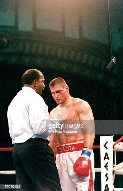 Andrew Golota is counted out during the fight against Riddick Bowe at the Convention Center on December 141996 in Atlantic City New Jersey Riddick...