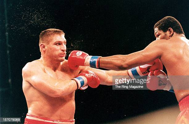 Andrew Golota is hit with a left hook from Riddick Bowe during a fight at the Convention Center on December 14 1996 in Atlantic City New Jersey...