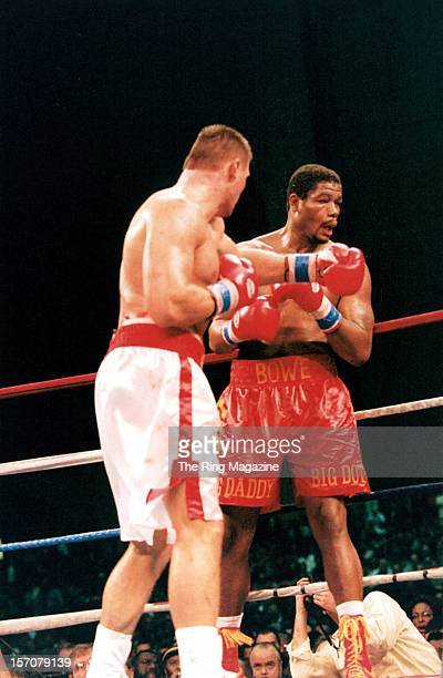 Andrew Golota lands a left hook to Riddick Bowe during the fight at at the Convention Center on December 141996 in Atlantic City New Jersey Riddick...