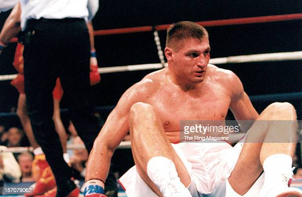 Andrew Golota lays on the canvas after being knocked down by Riddick Bowe during a fight at the Convention Center on December 14 1996 in Atlantic...
