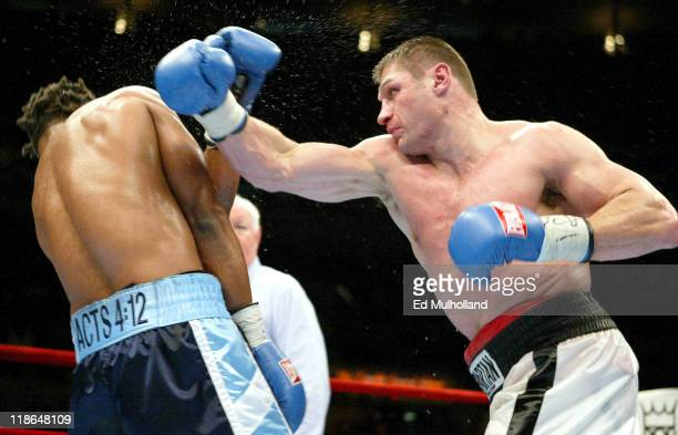 Andrew Golota throws a right hand at IBF Heavyweight Champion Chris Byrd during their 12 round fight at Madison Square Garden Byrd retained the title...