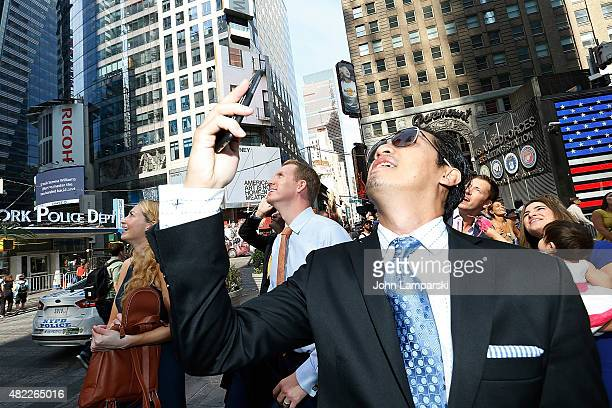 Andrew Greenwell rear center rings the Nasdaq Stock Market opening bell celebrating the Million Dollar Listing San Francisco during opening bell at...