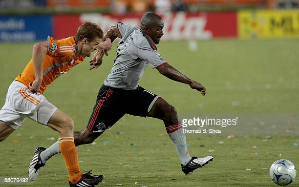 Andrew Hainault of the Houston Dynamo chases Marvell Wynne of Toronto FC at Robertson Stadium on May 30 2009 in Houston Texas