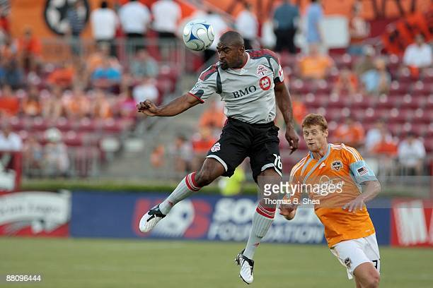 Andrew Hainault of the Houston Dynamo defends Marvell Wynne of Toronto FC at Robertson Stadium on May 30 2009 in Houston Texas The Houston Dynamo...