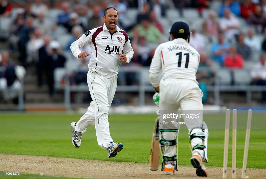 Andrew Hall (L) of Northants celebrates the wicket of Lancashire's Andrea Agathangelou during day one of the LV County Championship Division Two match between Lancashire and Northamptonshire at Old Trafford on June 20, 2013 in Manchester, England.