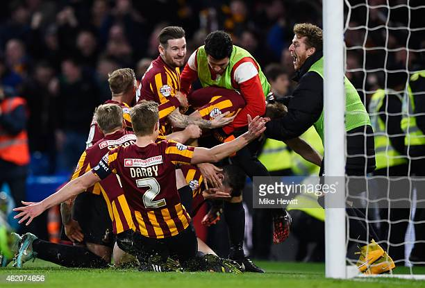 Andrew Halliday of Bradford City is congratulated by teammates after scoring his team's third goal during the FA Cup Fourth Round match between...