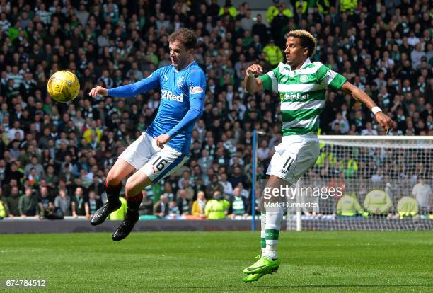 Andrew Halliday of Rangers out jumps Scott Sinclair of Celtic during the Ladbrokes Scottish Premiership match between Rangers FC and Celtic FC at...