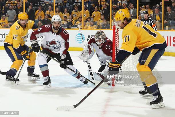 Andrew Hammond and Mark Barberio of the Colorado Avalanche eye the puck on the stick of Scott Hartnell of the Nashville Predators as Mike Fisher...