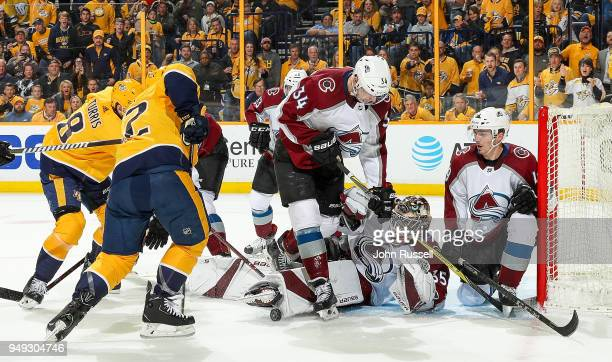 Andrew Hammond of the Colorado Avalanche makes the save against Kevin Fiala of the Nashville Predators as Carl Soderberg and Samuel Girard defend in...