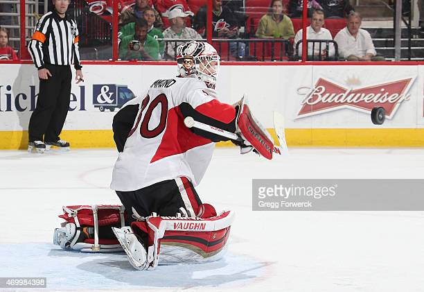 Andrew Hammond of the Ottawa Senators blockers he puck away from the goal during their NHL game at PNC Arena on March 17 2015 in Raleigh North...