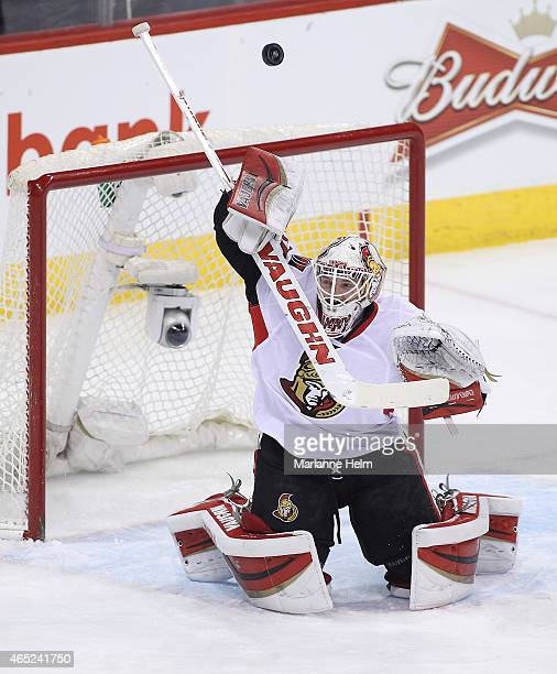 Andrew Hammond of the Ottawa Senators blocks a shot on goal in firstperiod action in an NHL game against the Winnipeg Jets at the MTS Centre on March...