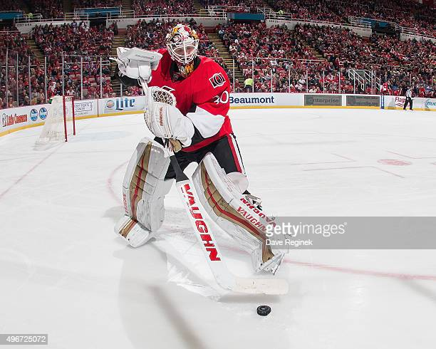 Andrew Hammond of the Ottawa Senators controls the puck during an NHL game against the Detroit Red Wings at Joe Louis Arena on October 30 2015 in...