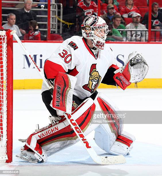 Andrew Hammond of the Ottawa Senators crouches in the crease to protect the net during their NHL game against the Carolina Hurricanes at PNC Arena on...