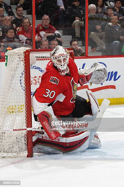 Andrew Hammond of the Ottawa Senators follows the play against the Pittsburgh Penguins at Canadian Tire Centre on April 7 2015 in Ottawa Ontario...