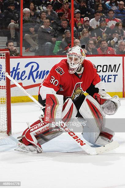 Andrew Hammond of the Ottawa Senators guards his net against the Pittsburgh Penguins at Canadian Tire Centre on April 7 2015 in Ottawa Ontario Canada