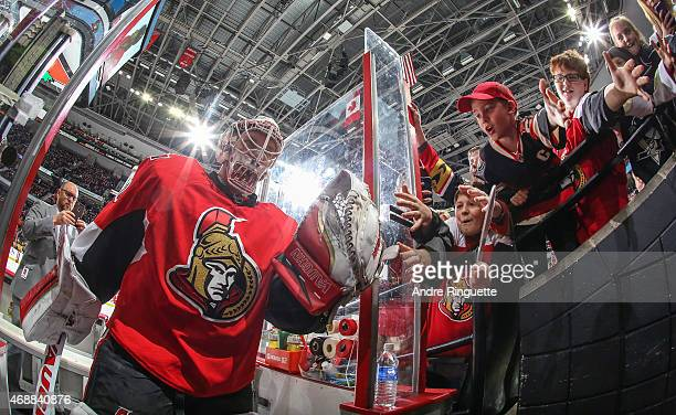 Andrew Hammond of the Ottawa Senators highfives fans as he leaves the ice after warmup prior to a game against the Pittsburgh Penguins at Canadian...