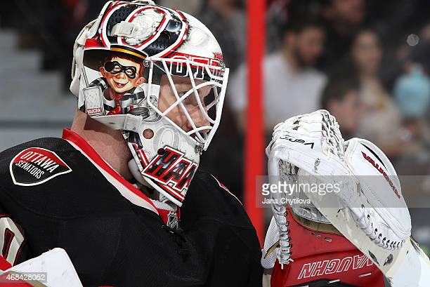 Andrew Hammond of the Ottawa Senators looks on during a break in action against the Tampa Bay Lightning at Canadian Tire Centre on April 2 2015 in...