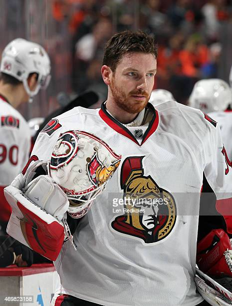 Andrew Hammond of the Ottawa Senators looks on during a timeout against the Philadelphia Flyers on April 11 2015 at the Wells Fargo Center in...