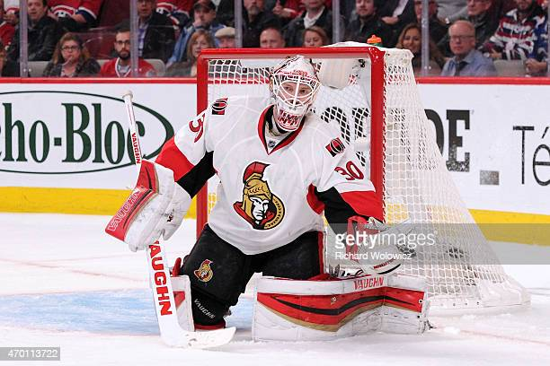 Andrew Hammond of the Ottawa Senators makes a glove save on the puck during Game One of the Eastern Conference Quarterfinals during of the 2015 NHL...