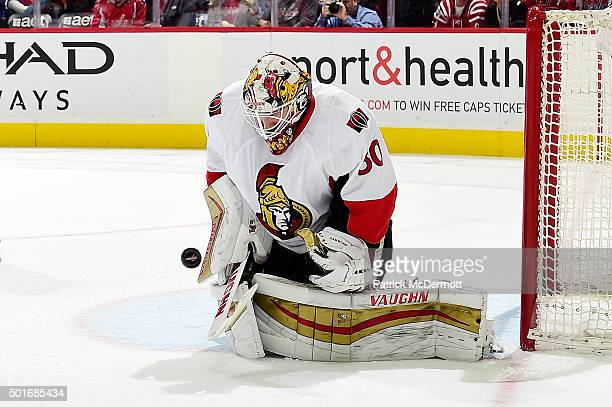 Andrew Hammond of the Ottawa Senators makes a save against the Washington Capitals in the first period during an NHL game at Verizon Center on...