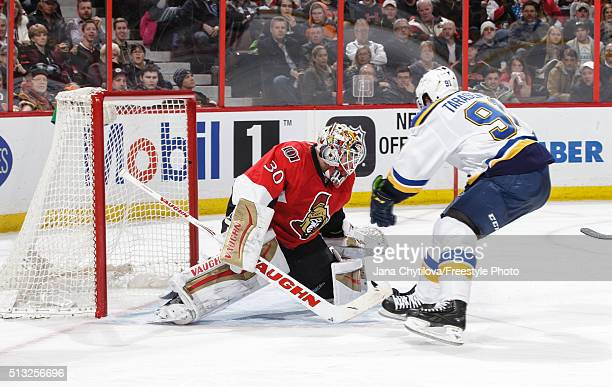 Andrew Hammond of the Ottawa Senators makes a save against Vladimir Tarasenko of the St Louis Blues on a break away during an NHL game at Canadian...