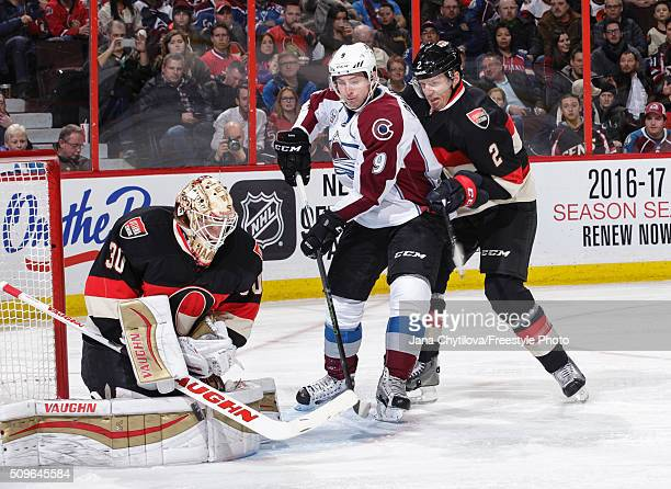 Andrew Hammond of the Ottawa Senators makes a save as team mate Dion Phaneuf defends against Matt Duchene of the Colorado Avalanche during an NHL...