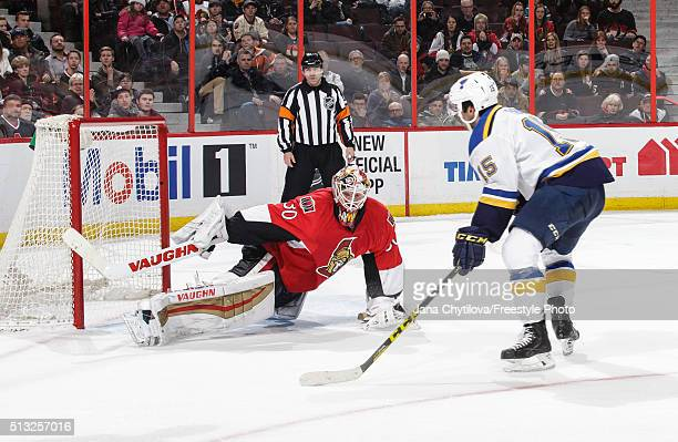 Andrew Hammond of the Ottawa Senators makes a sprawling save on the shootout against Robby Fabbri of the St Louis Blues during an NHL game at...
